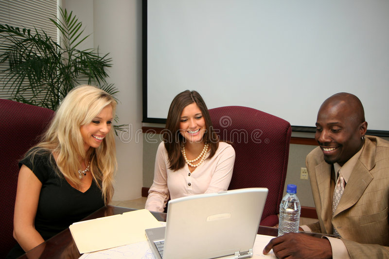 Business Team. In an office ready for the work day royalty free stock image