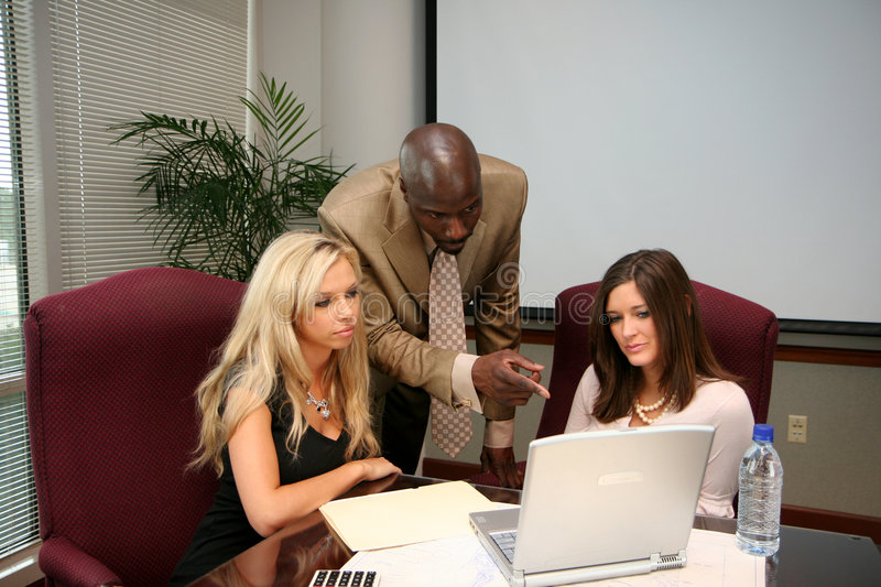 Business Team. In an office ready for the work day stock photos