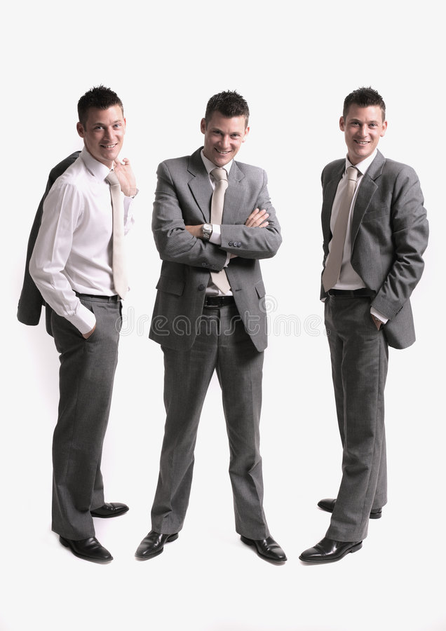 Business team. Scene, three separate businessmen silhouettes (clones) isolated over white background royalty free stock photography