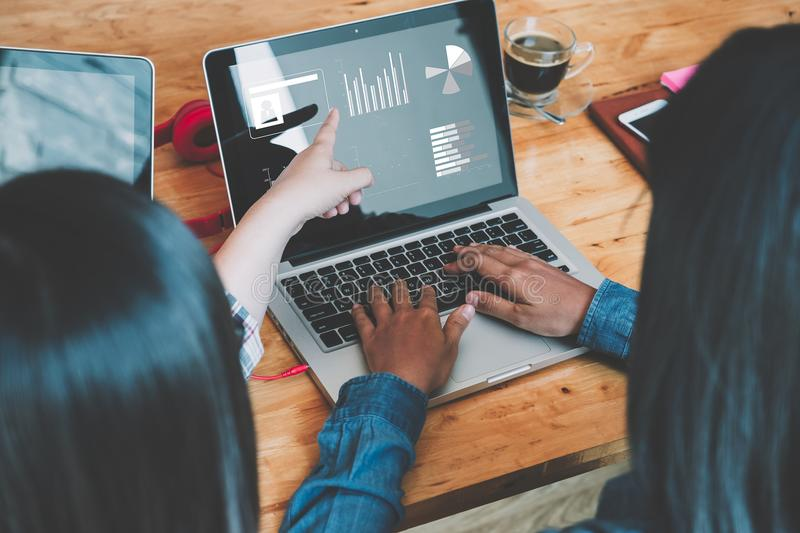 Business team analyzing income charts and graphs with modern lap royalty free stock photography