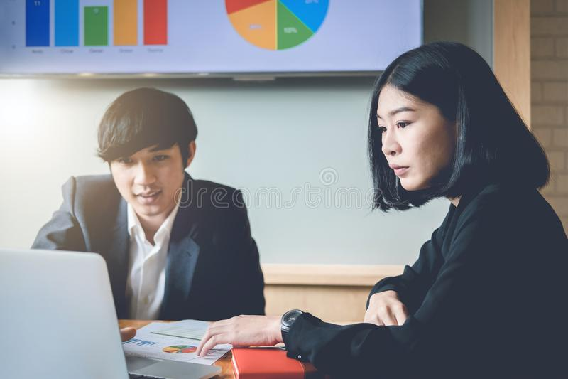Business team analyzing income charts and graphs with modern lap royalty free stock photo