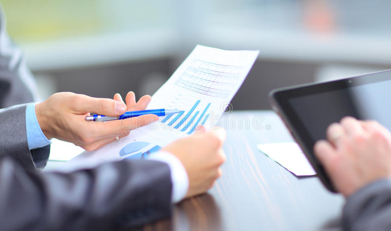 Business team analyzing market research results royalty free stock photography