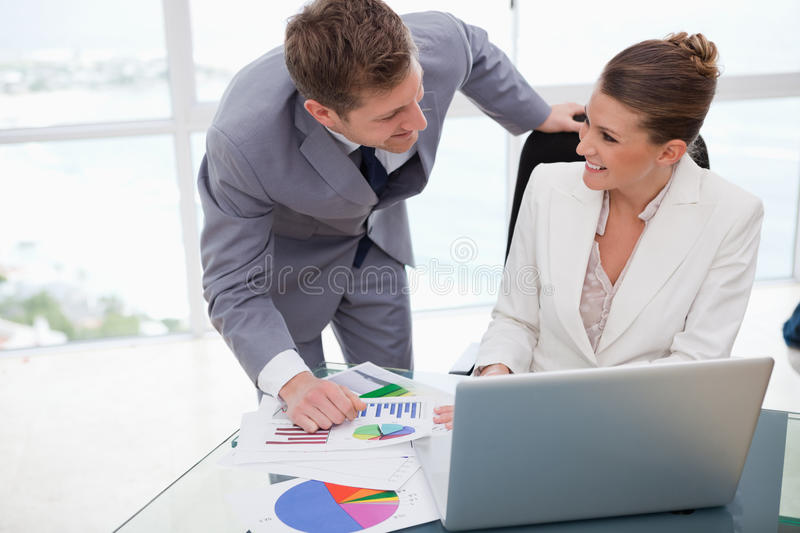 Business team analyzing poll results stock photo