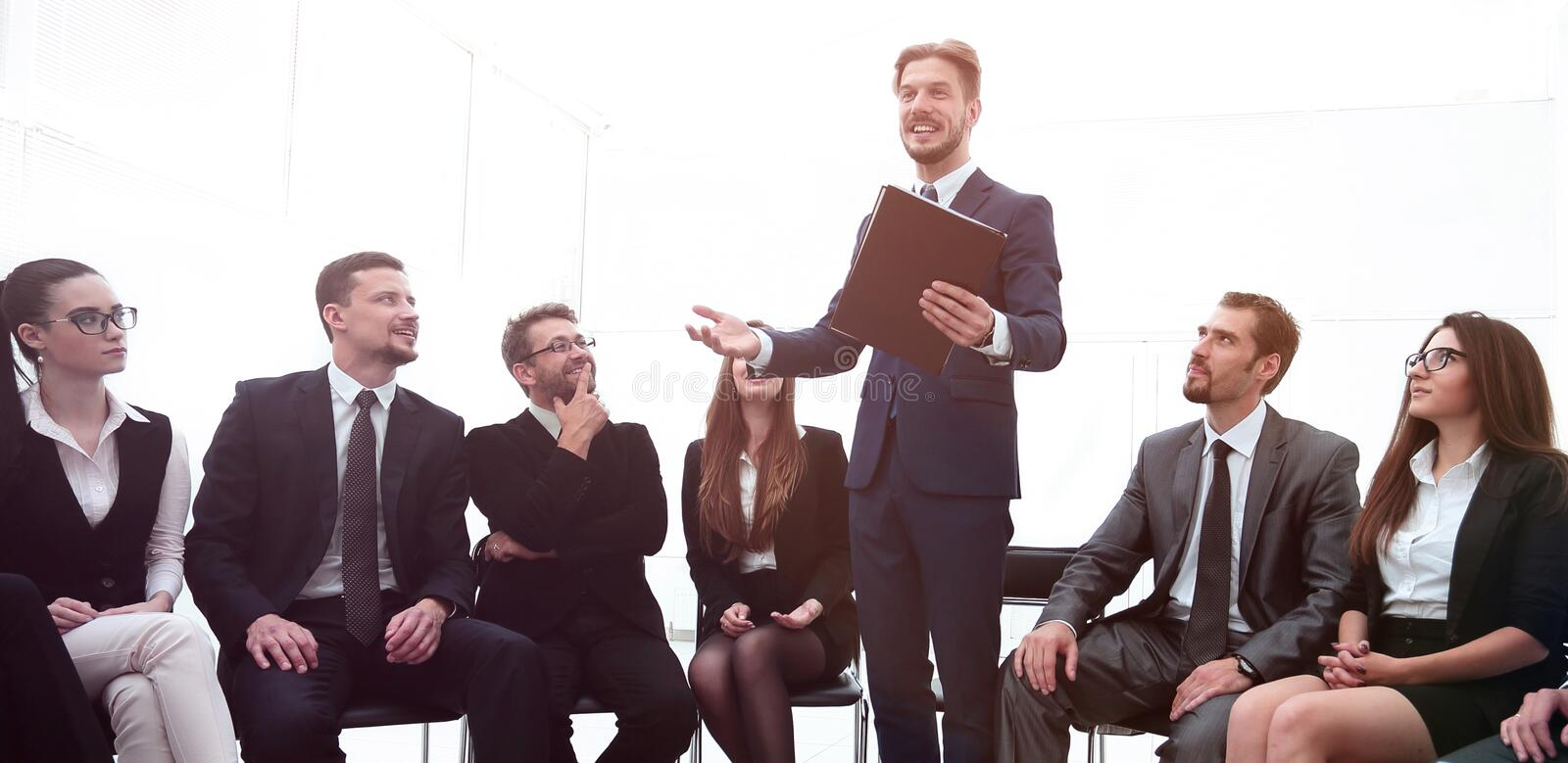 Business team applauding the coach. After the lesson on team building stock images