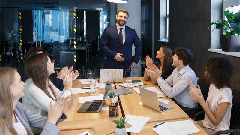 Business team applauding to leader, congratulating with project royalty free stock photography
