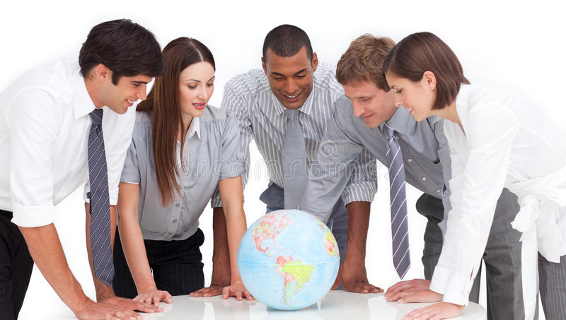 Business team around a terrestrial globe stock photography