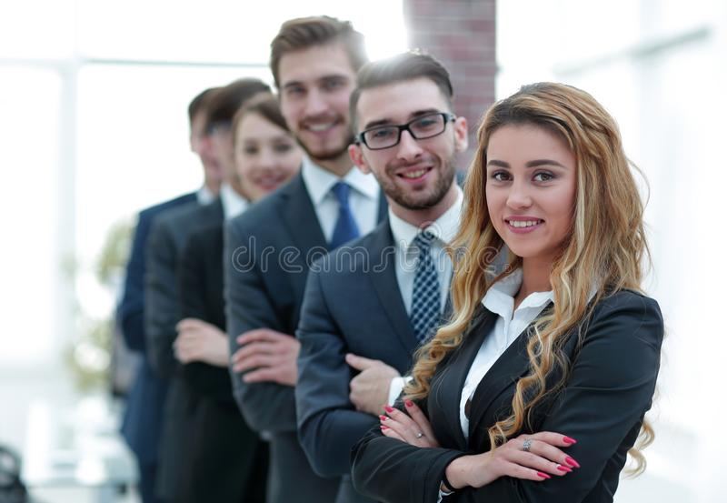 Business team in the background of the office. Friendly business team in the background of the office.photo with copy space royalty free stock photography