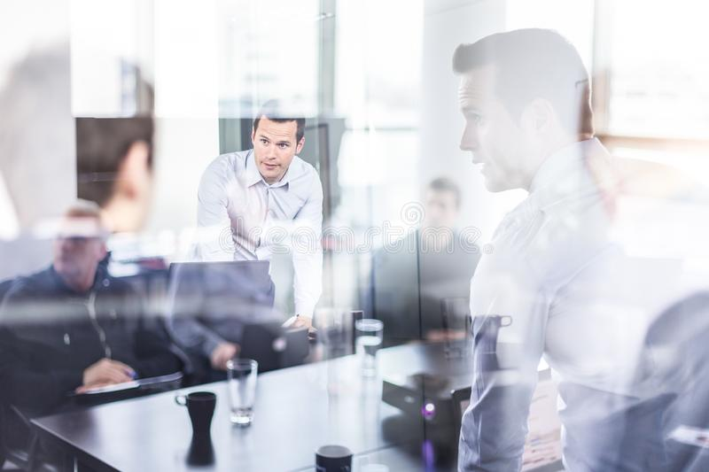 Business team brainstorming on meeting in modern corporate office. Business executive delivering presentation to colleagues during meeting or in-house business stock image