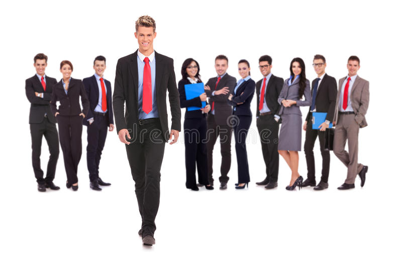 Business team with a business man walking forward royalty free stock images