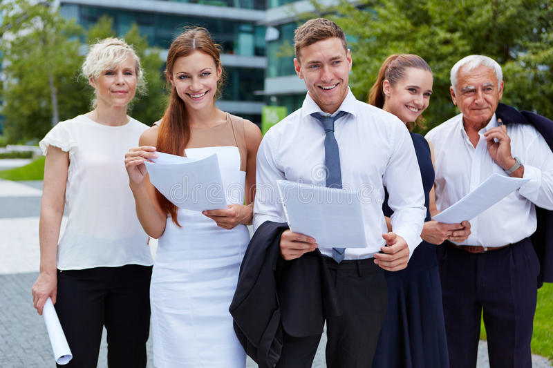 Business team with businesspeople smiling royalty free stock photo