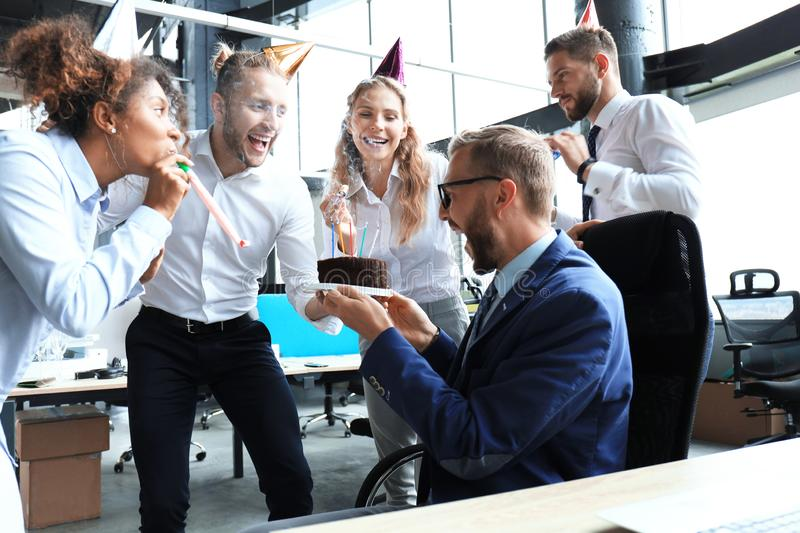 Business team celebrating a birthday of collegue in the modern office.  royalty free stock photos