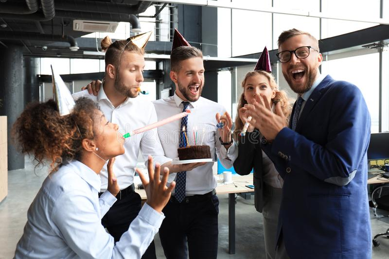 Business team celebrating a birthday of collegue in the modern office.  stock image