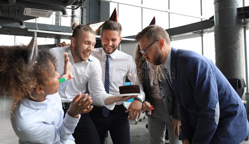 Business team celebrating a birthday of collegue in the modern office.  royalty free stock photo
