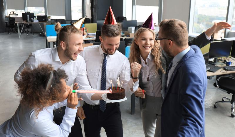 Business team celebrating a birthday of collegue in the modern office.  stock photos