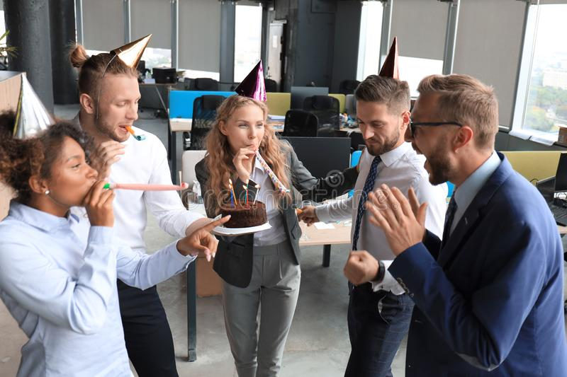 Business team celebrating a birthday of collegue in the modern office.  royalty free stock images
