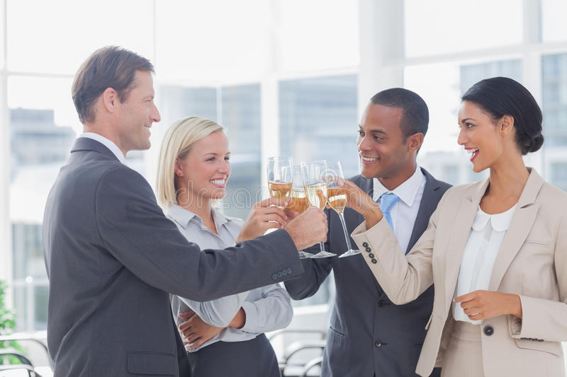 Business team celebrating with champagne and toasting royalty free stock photos