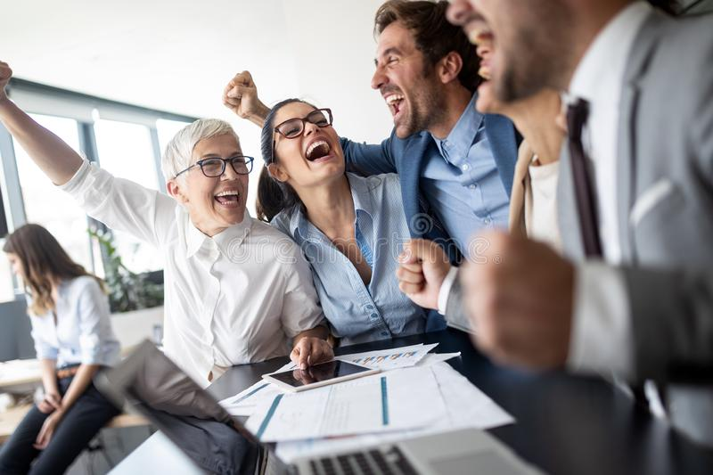 Business team celebrating a good job in the office royalty free stock images