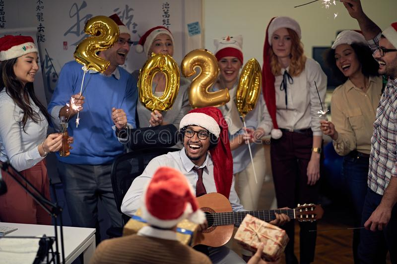 Business team celebrating new 2020 year in office royalty free stock photos