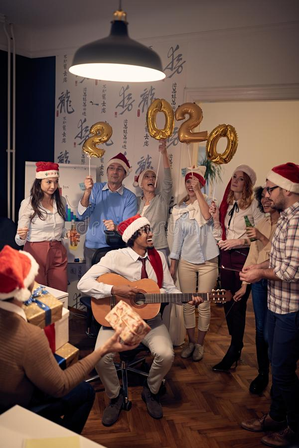 Business team celebrating new 2020 year in office royalty free stock images