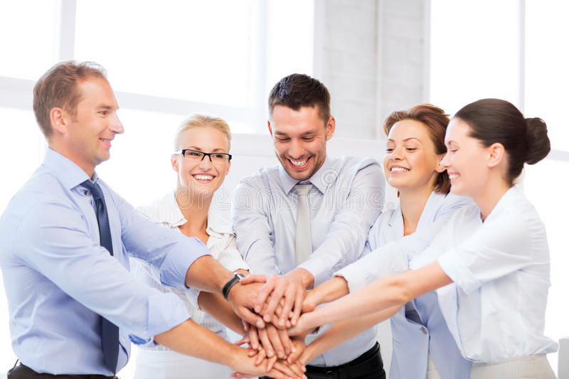 Business team celebrating victory in office. Picture of happy business team celebrating victory in office royalty free stock photos