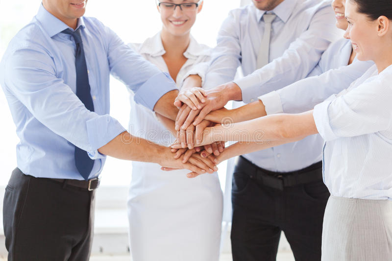 Business team celebrating victory in office. Success and winning concept - happy business team celebrating victory in office stock photos