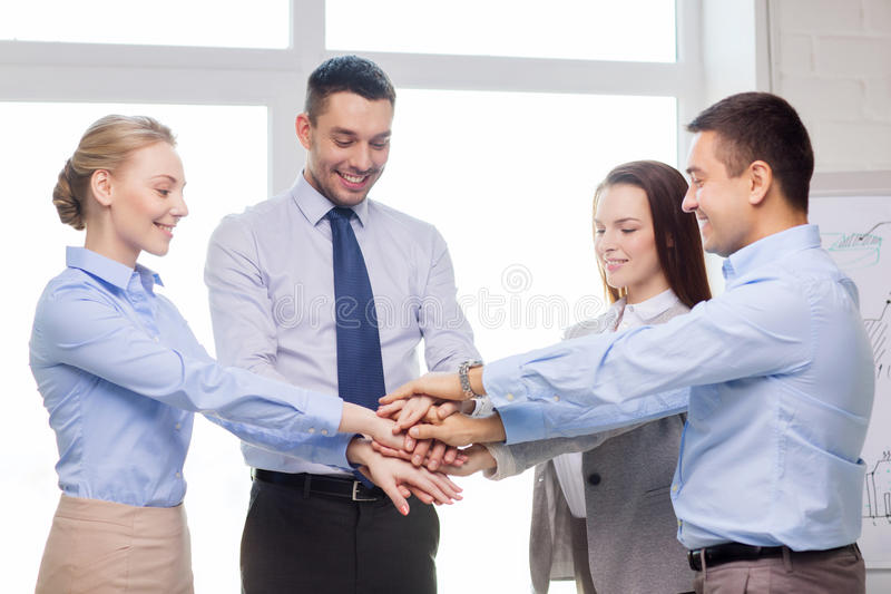Business team celebrating victory in office. Success, business, office and winning concept - happy business team celebrating victory in office stock photography