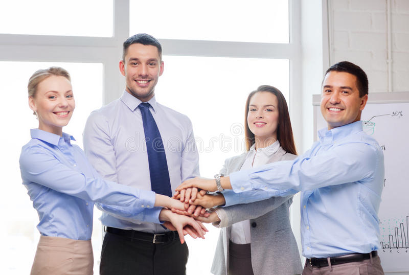 Business team celebrating victory in office. Success, business, office and winning concept - happy business team celebrating victory in office royalty free stock photo