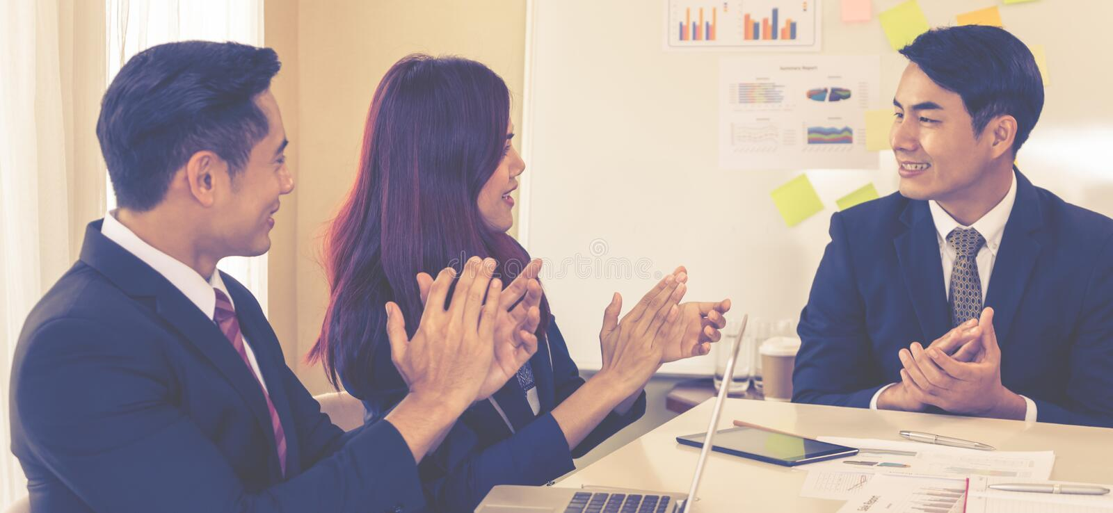 Business team clapping applaud for successful meeting. Business team is clapping applaud for successful meeting stock photography