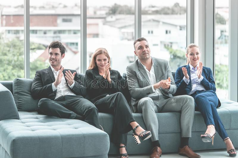 Business team clapping applaud for successful meeting. Business team is clapping applaud for successful meeting stock photo