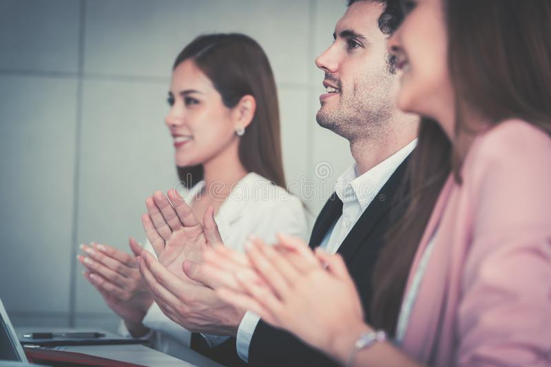 Business team clapping applaud for successful meeting. Business team is clapping applaud for successful meeting stock image