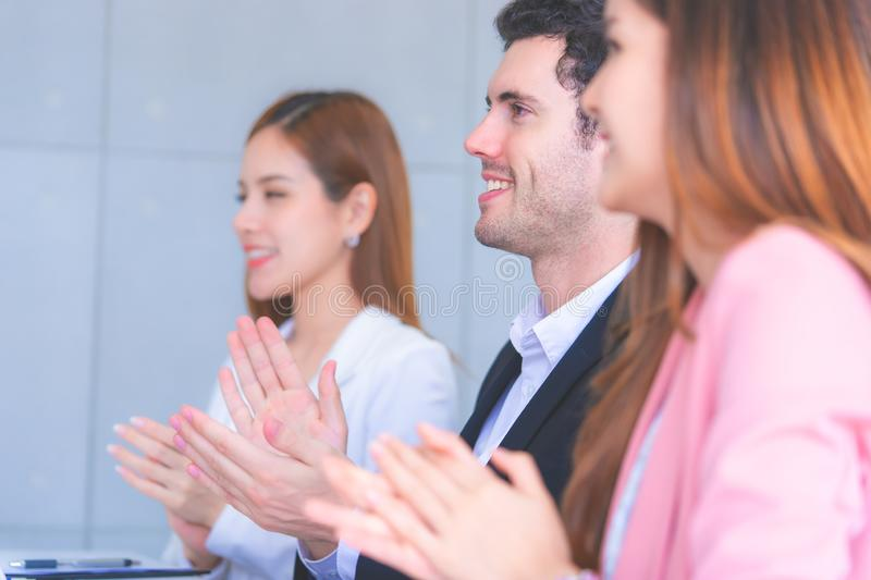 Business team clapping applaud for successful meeting. Business team is clapping applaud for successful meeting royalty free stock image