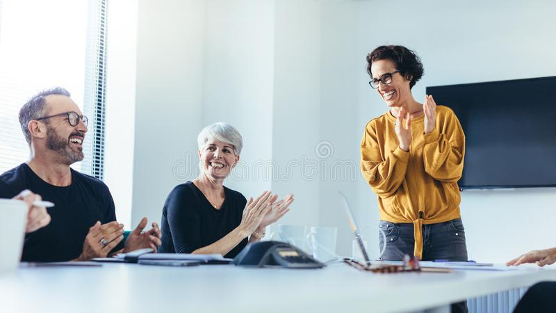 Business team clapping hands stock photos