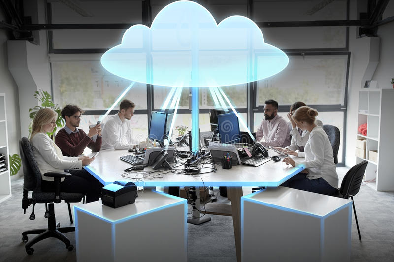 Business team with cloud computing hologram royalty free stock images
