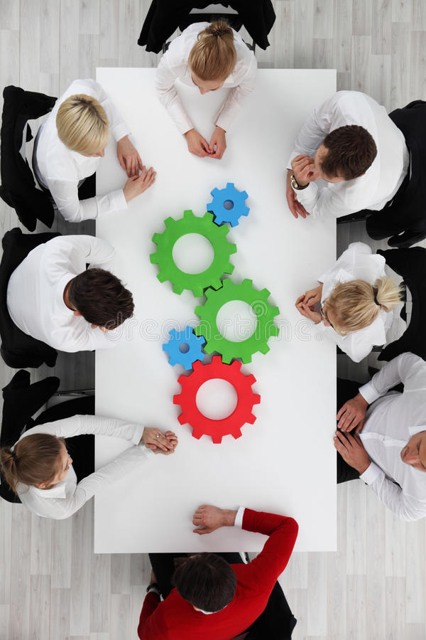 Business team with cogs stock images