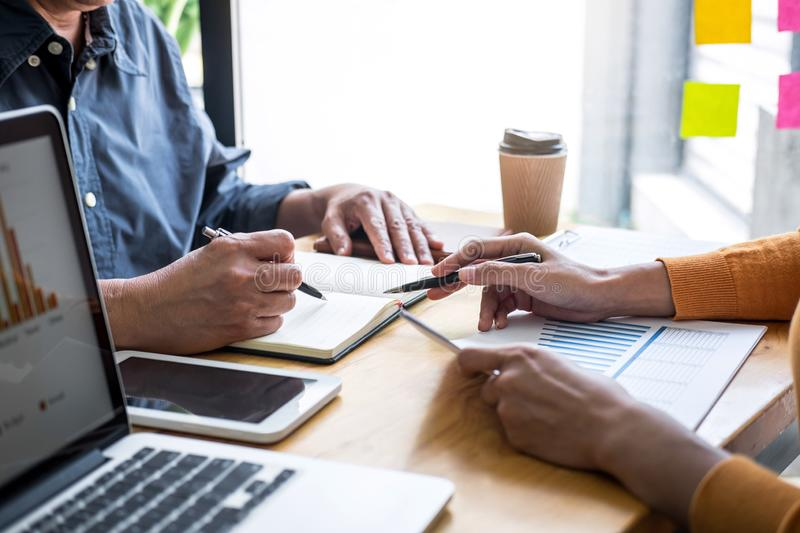 Business team collaboration discussing working analyzing with financial data and marketing growth report graph in team,. Presentation and brainstorming to royalty free stock photography
