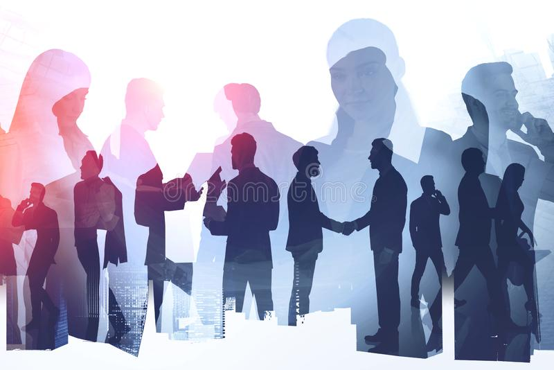 Business team. Collaboration and partnership. Silhouettes of diverse business people working together and shaking hands in modern city. Concept of teamwork and royalty free stock photos