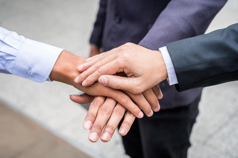Business team collaboration showing unity with their hands stack royalty free stock photography