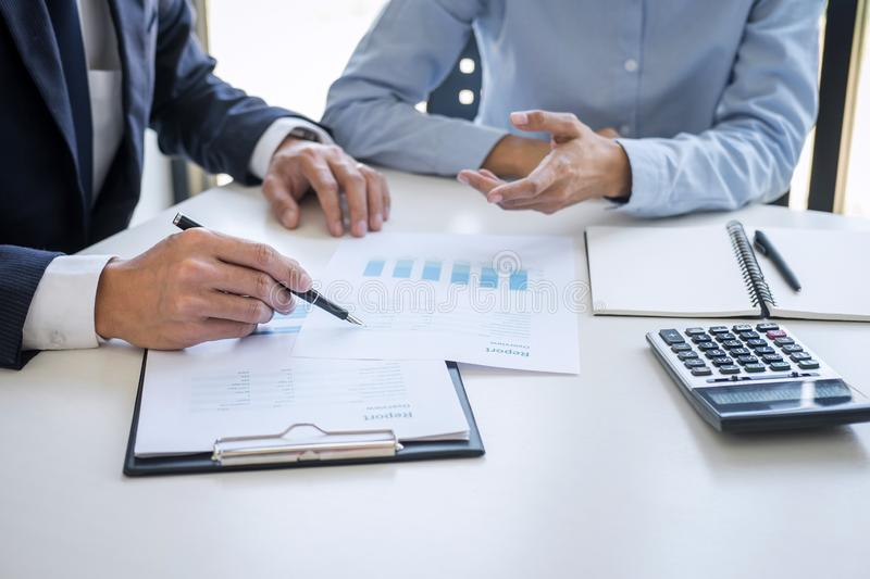 Business team colleagues discussing working analyzing with financial data and marketing growth report graph in team consultation stock photo