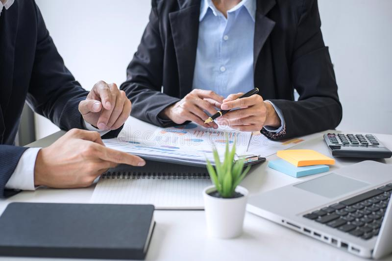 Business team colleagues discussing working analyzing with financial data and marketing growth report graph in team consultation royalty free stock photo