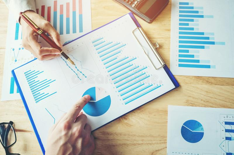 Business team colleagues meeting Planning Strategy Analysis disc. Ussing new plan financial graph data on office stock image