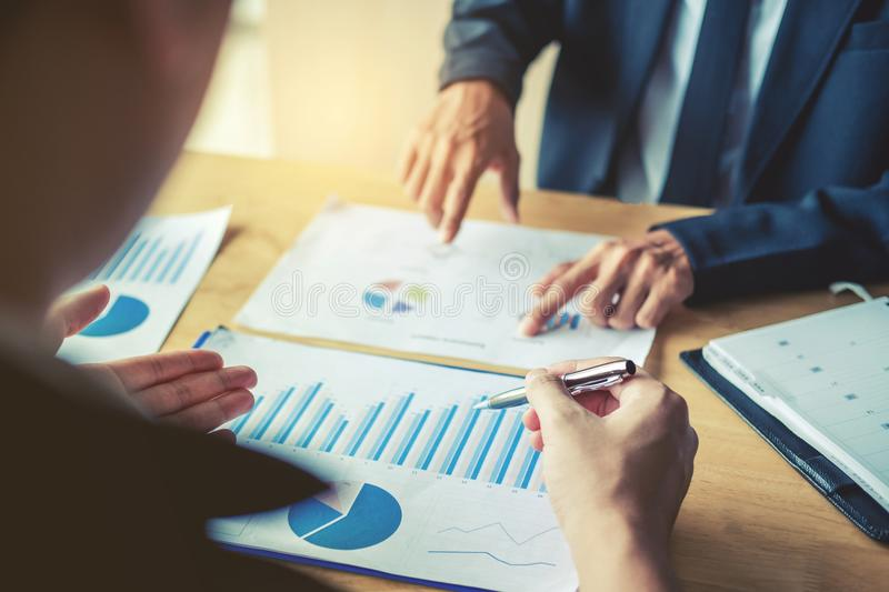 Business team colleagues meeting Planning Strategy Analysis disc. Ussing new plan financial on graph data new business project royalty free stock photo