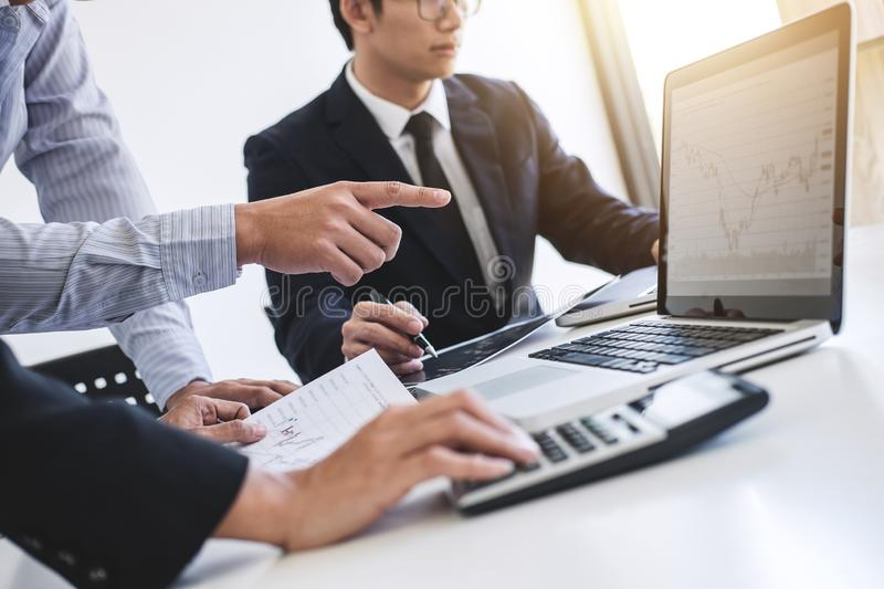 Business team colleagues working with computer, laptop, discussing and analysis graph stock market trading with stock chart. Data, financial and investment stock photo