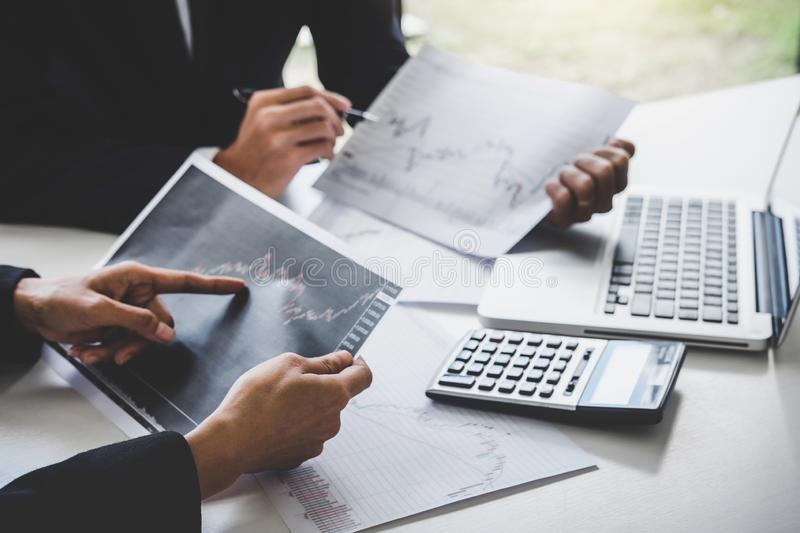 Business team colleagues working with computer, laptop, discussing and analysis graph stock market trading with stock chart data,. Financial and investment royalty free stock photography