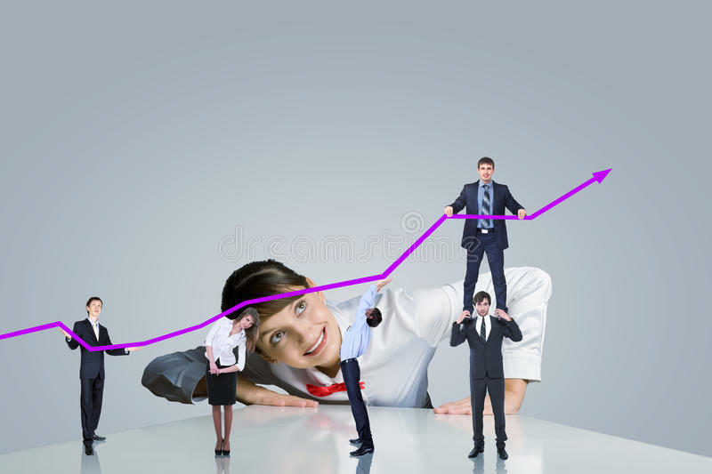 Business team concept. Businesswoman looking at businessteam holding increasing graph royalty free stock image
