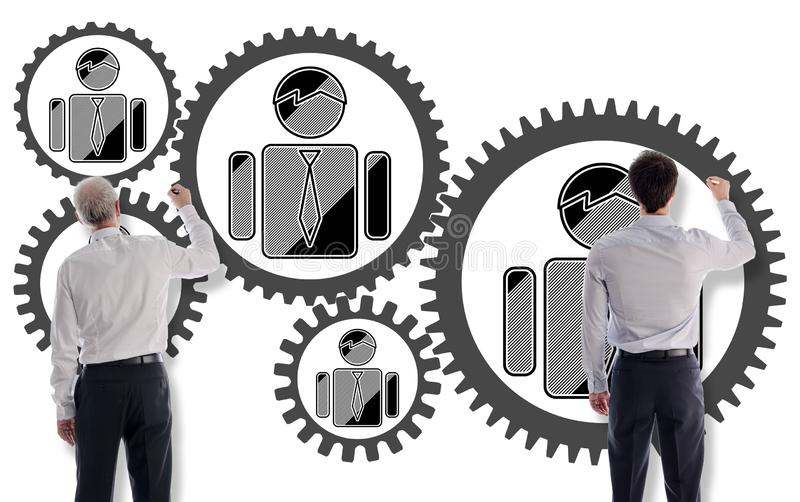 Business team concept drawn by businessmen. Business team concept drawn on a white wall by businessmen royalty free stock images