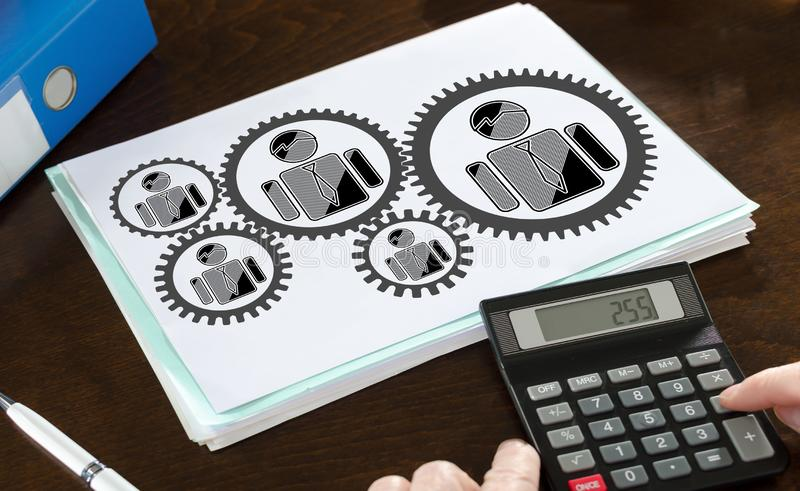 Business team concept illustrated on a paper. With a calculator stock photos