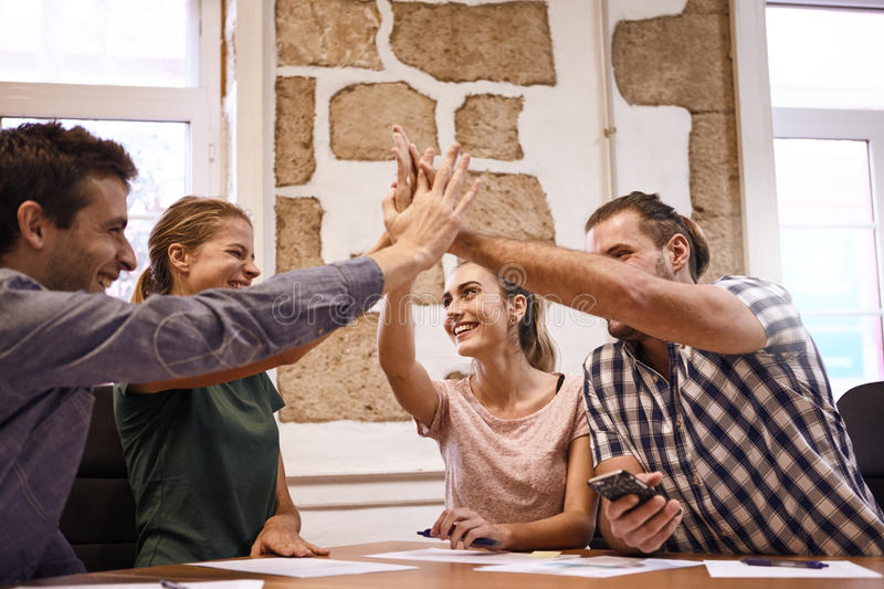 Business team concluding success in meeting stock image