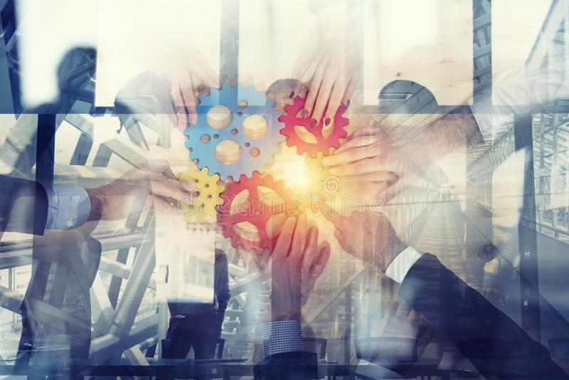 Business team connect pieces of gears. Teamwork, partnership and integration concept. double exposure royalty free stock image