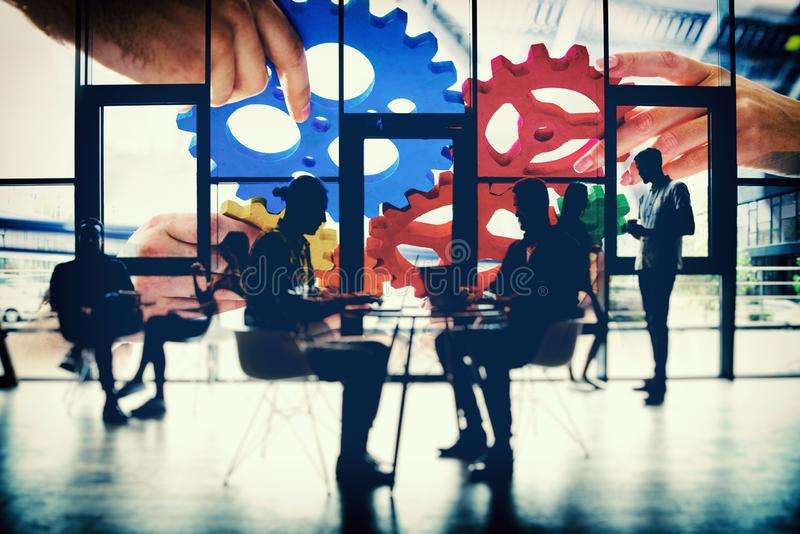 Business team connect pieces of gears. Teamwork, partnership and integration concept. double exposure with light effects. Business people work together in office royalty free stock photo