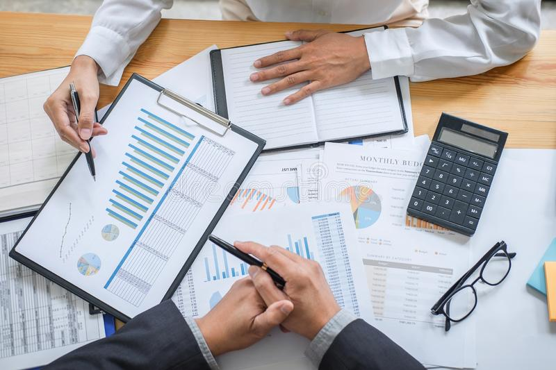 Business team consultant working with new startup growth project plan and discussion analyzing for financial strategy statistics stock photo